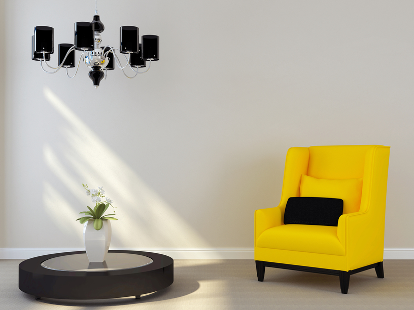 Black chandelier and yellow chair